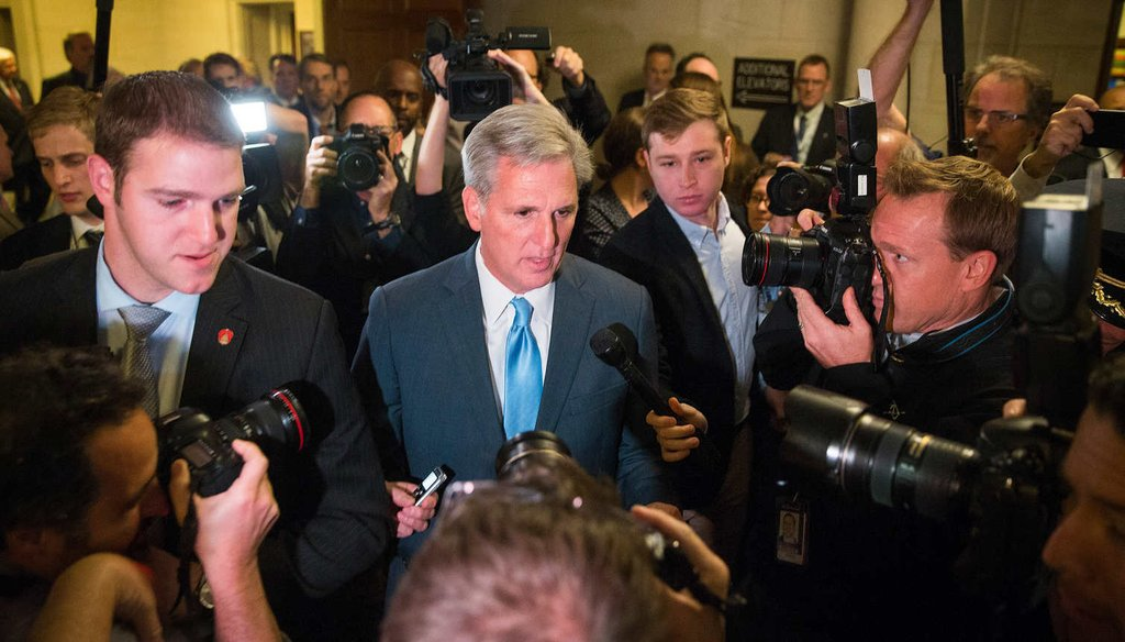 House Majority Leader Kevin McCarthy (R-Calif.) , surrounded by reporters, unexpectedly dropped his bid to be House Speaker. (NYT)