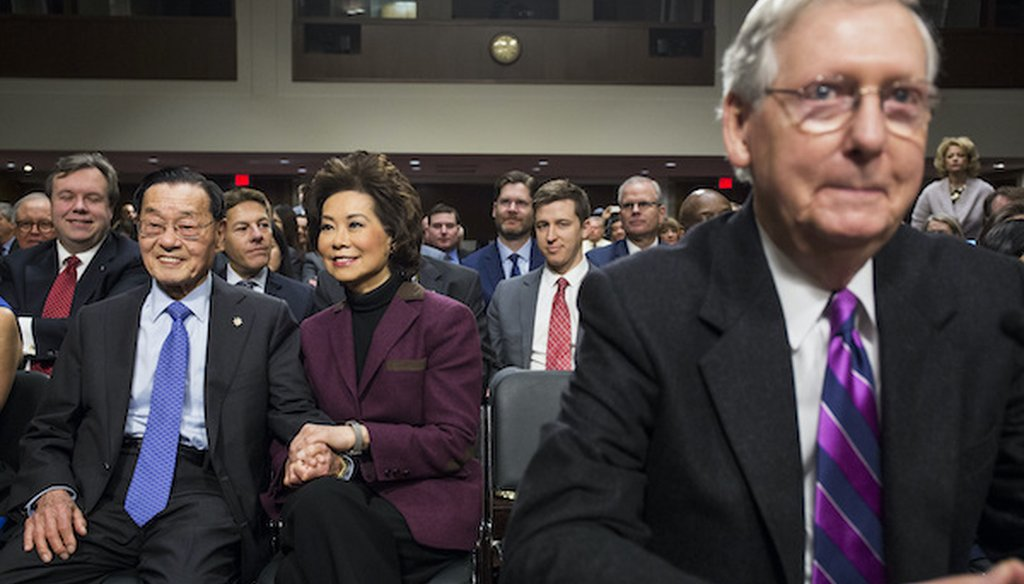 Secretary of Transportation-designate Elaine Chao sits with her father James Chao in Washington in 2017, prior to the start of her confirmation hearing where her husband, Senate Majority Leader Mitch McConnell introduced her. (Associated Press)