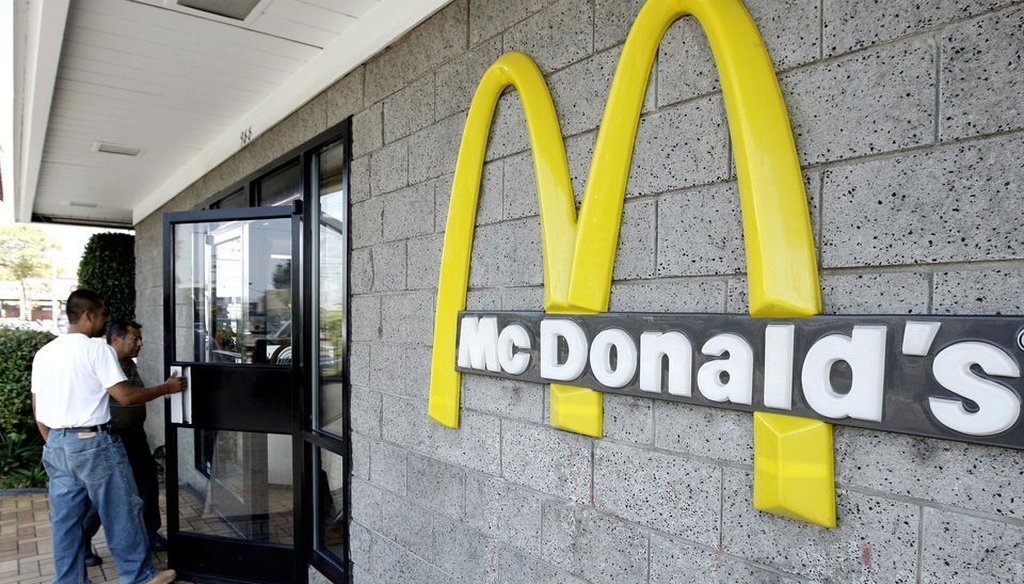 Two customers walk inside one of the 14,000 McDonald's restaurants in the country. Atlanta-based civil rights activist, the Rev. Markel Hutchins, says there are twice as many gun stores in the United States than McDonald's.