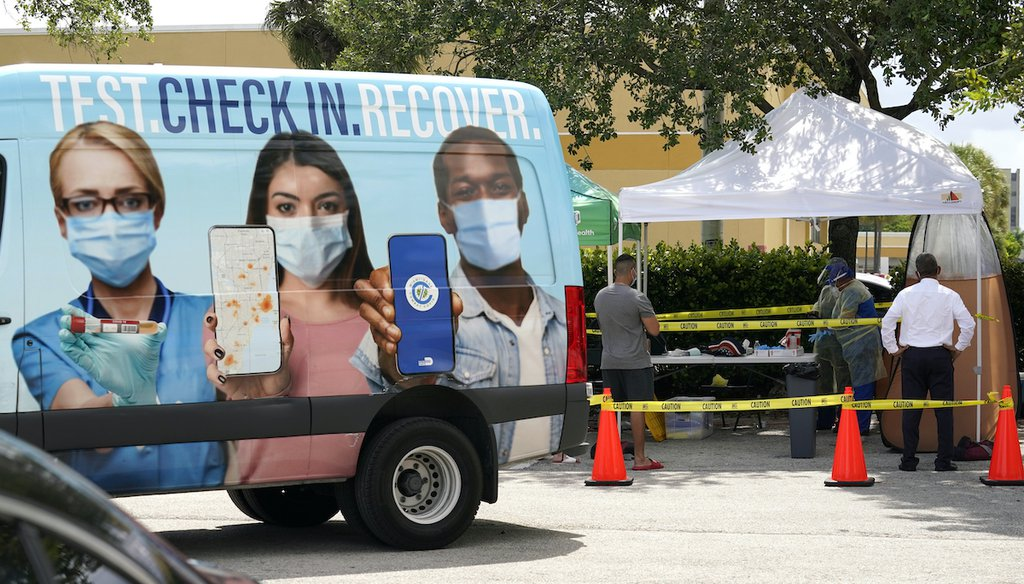 People wait in line at a Miami-Dade County COVID-19 testing site on July 26, 2021, in Hialeah, Fla. (AP)