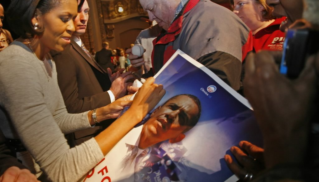 Michelle Obama signed an autograph after giving a campaign speech for Barack Obama in Milwaukee on Feb. 18, 2008, before her husband was elected president. (Milwaukee Journal Sentinel)