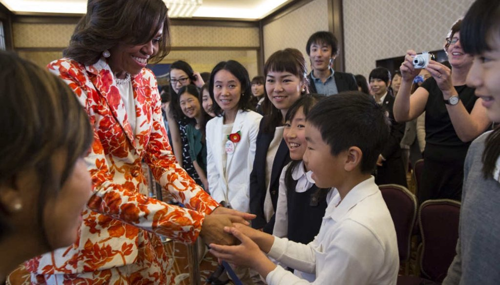 First lady Michelle Obama greets students following the Let Girls Learn announcement at the Iikura Guest House in Tokyo, Japan, March 19, 2015. (White House)