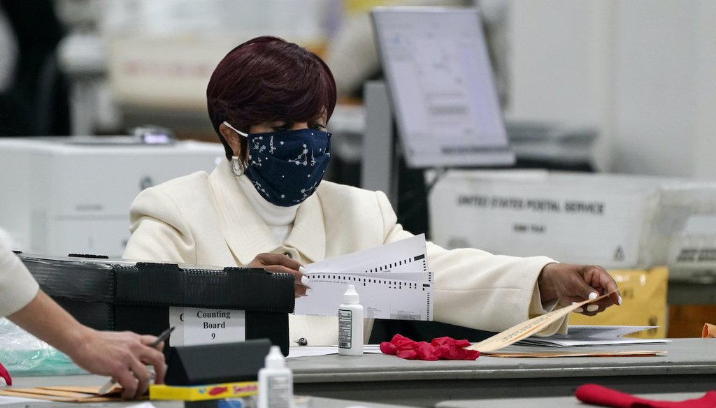 Absentee ballots are processed at the central counting board, Wednesday, Nov. 4, 2020, in Detroit. (AP)