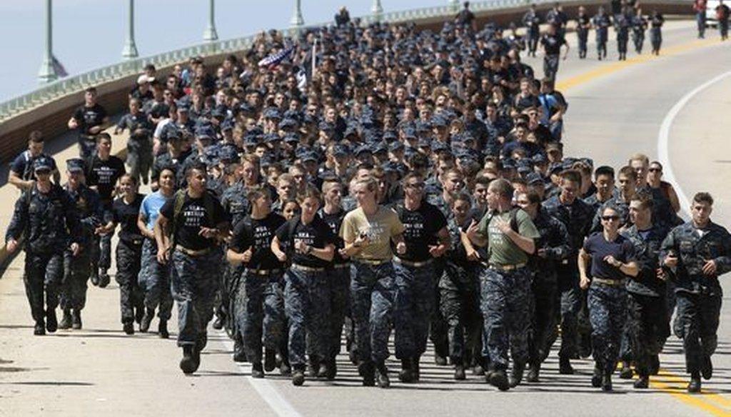 Midshipmen run across a bridge during Sea Trials. (Associated Press)