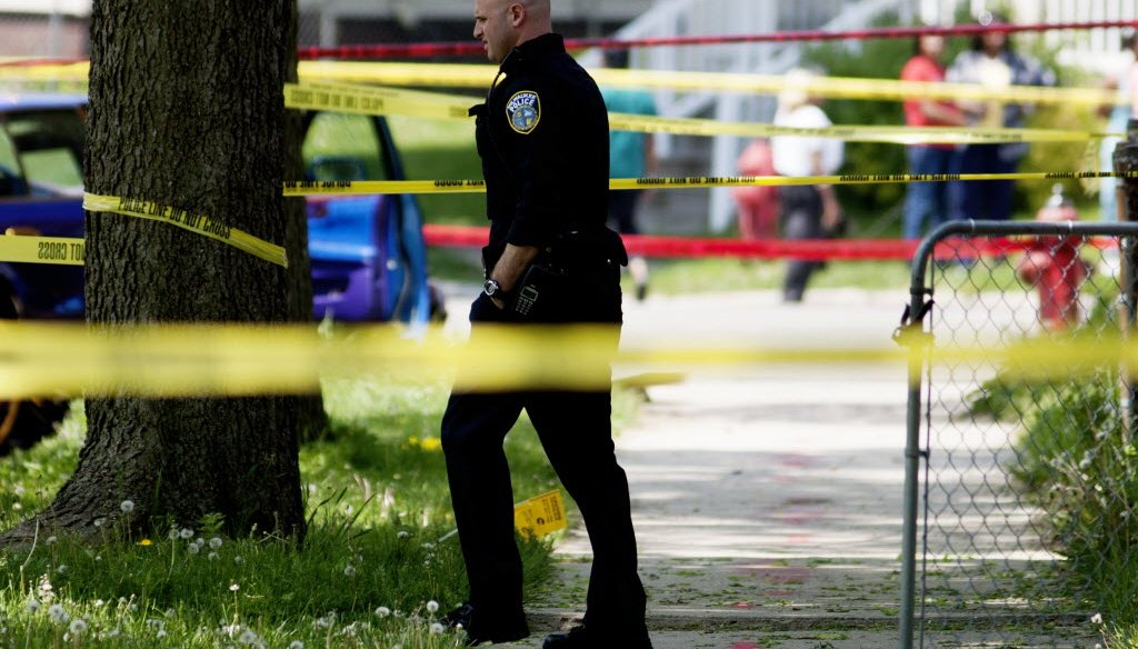 Police investigate the scene of a triple-shooting in Milwaukee on May 23, 2016. (Calvin Mattheis photo)