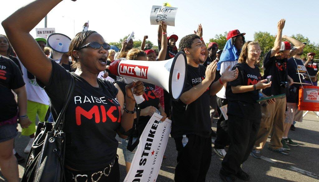 People seeking an increase in the minimum wage massed in Milwaukee in August 2013.