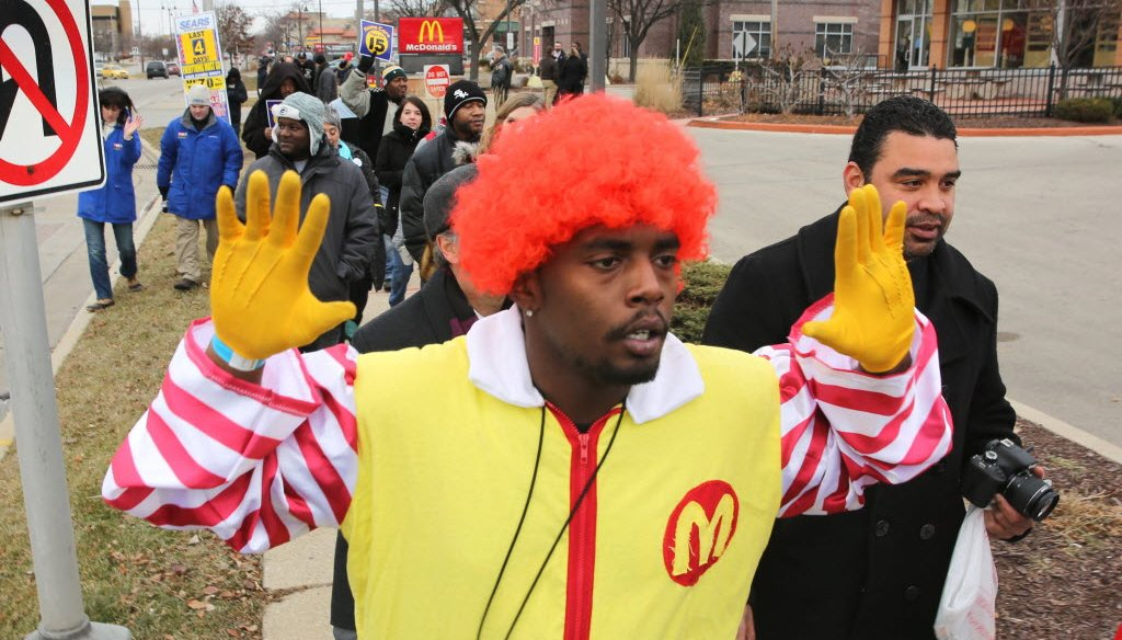 Fast food workers and supporters, including a man dressed as Ronald McDonald, rallied for a higher minimum wage in the Milwaukee suburb of Glendale on Dec. 4, 2014. (Mike De Sisti photo)