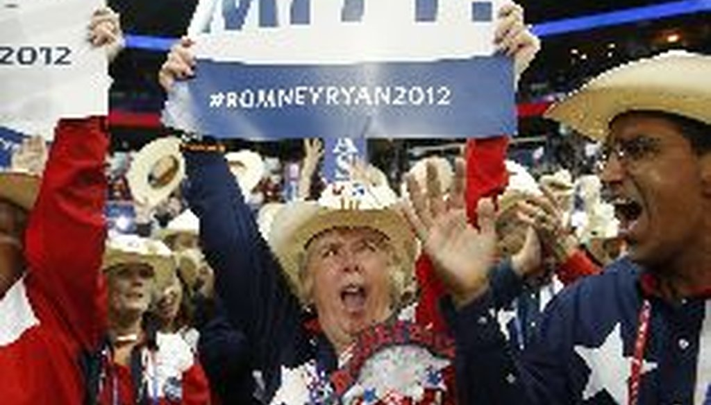 Texas delegates cheer as Mitt Romney is nominated as the GOP candidate for president at the Republican National Convention in Tampa, Fla. Tuesday.