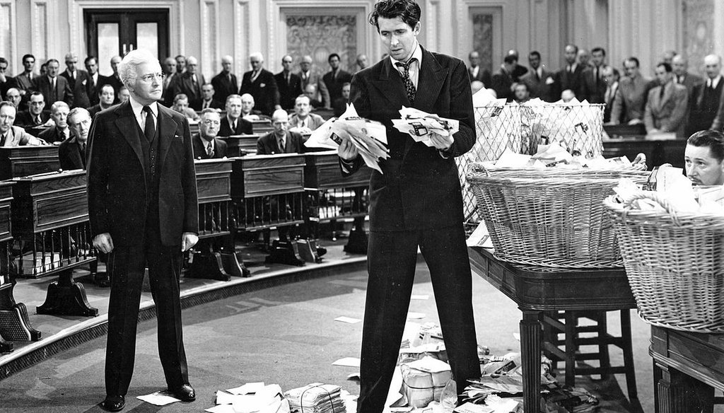 """Claude Rains and Jimmy Stewart in a promotional still from the 1939 film, """"Mr. Smith Goes to Washington."""" (Public domain)"""