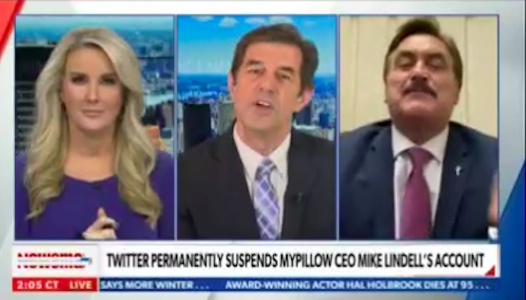 """A screenshot of Newsmax TV's """"American Agenda"""" featuring hosts Bob Sellers and Heather Childers and guest Mike Lindell, the CEO of MyPillow, during a Feb. 2 interview segment."""