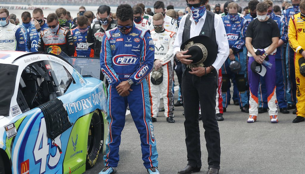 Team owner Richard Petty, right, stands next to driver Bubba Wallace during the national anthem prior to the start of the NASCAR Cup Series at the Talladega Superspeedway in Talladega, Ala., Monday, June 22, 2020. (AP Photo/John Bazemore)