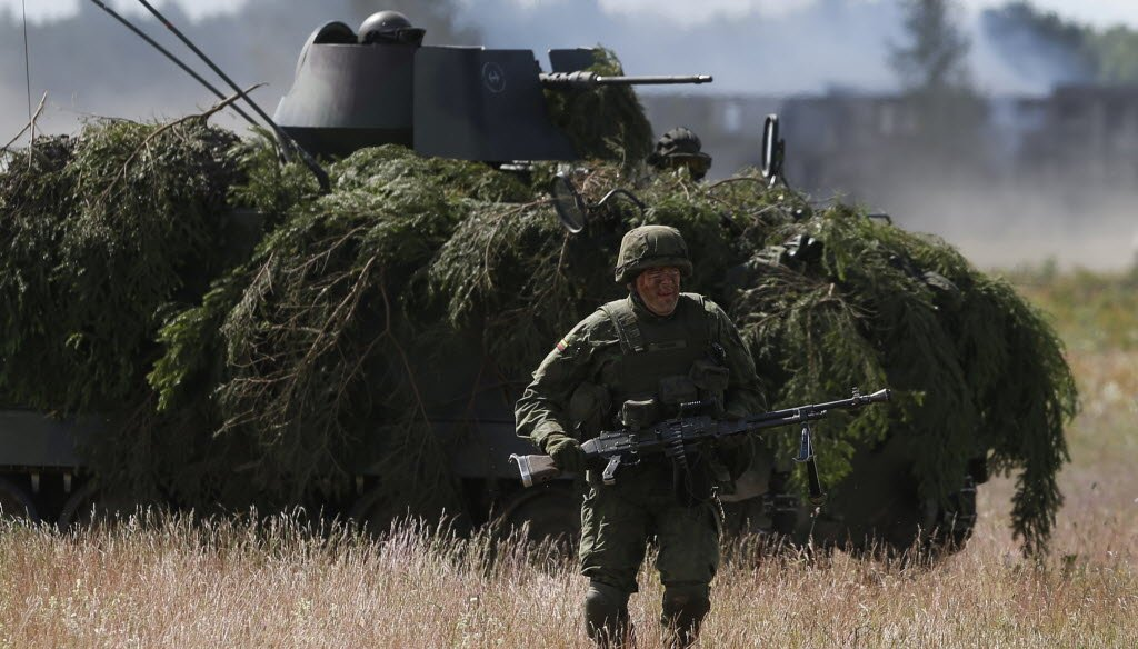 """Soldiers from different NATO countries participated in military exercise """"Saber Strike 2014"""" in Lithuania on June 17, 2014."""
