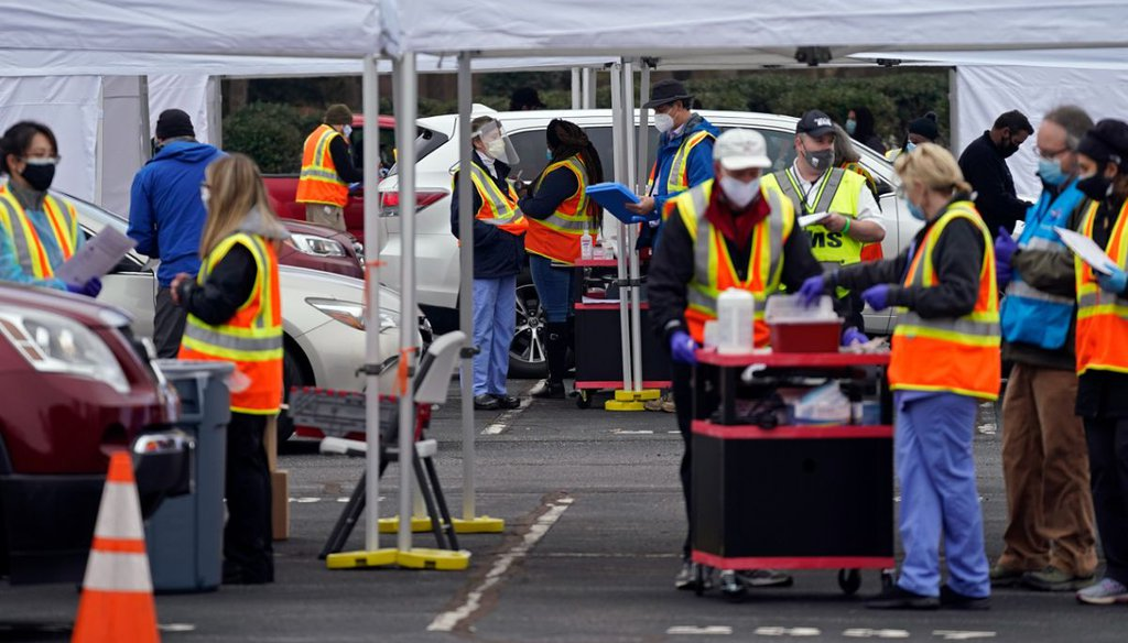 Medical personnel and volunteers operate a drive-thru COVID-19 mass vaccination event at PNC arena in Raleigh, N.C., on Feb. 11, 2021. (AP)