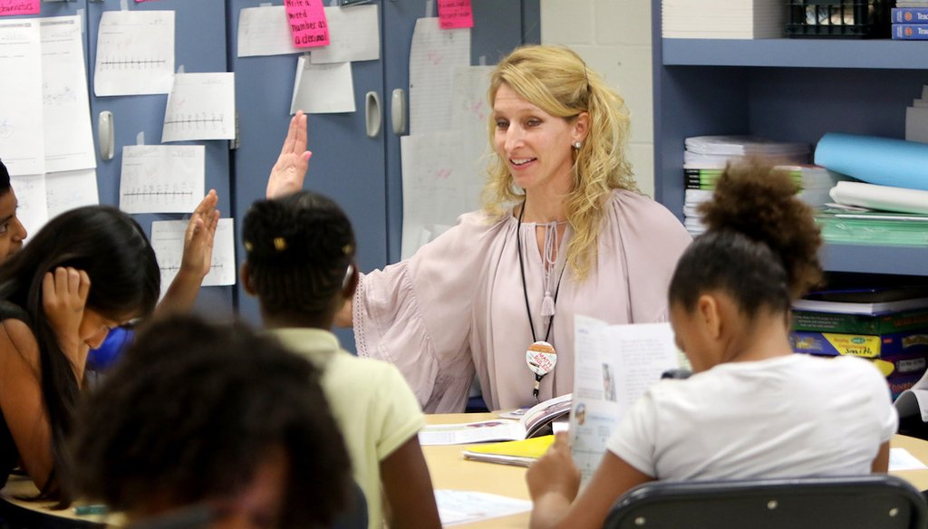 High Point Elementary School 4th-grade teacher Kristin Bierman works with a guided reading group on April 7, 2017, at the school in Clearwater. (DOUGLAS R. CLIFFORD | Times)