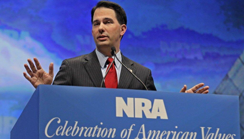 Gov. Scott Walker speaks at the National Rifle Association convention. (Michael Conroy/AP)