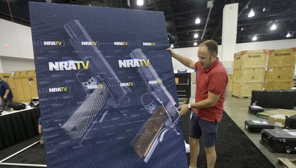 An NRA TV videographer helps set up for the NRA Carry Guard Expo in Milwaukee. (Mike De Sisti/Milwaukee Journal Sentinel)