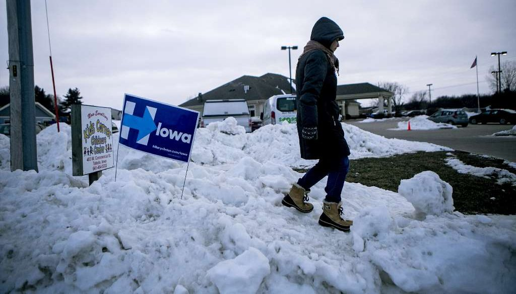 Mara Baron, an organizer for Hillary Clinton, waits out in the snow to direct cars to parking areas for an event where the Democratic presidential hopeful was speaking, in Toledo, Iowa, Jan. 18, 2016. (NYT)