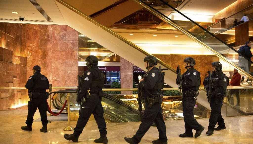 New York Police Department officers patrol the lobby of Trump Tower, on Fifth Avenue in Manhattan, Jan. 11, 2017. (Kevin Hagen/The New York Times)
