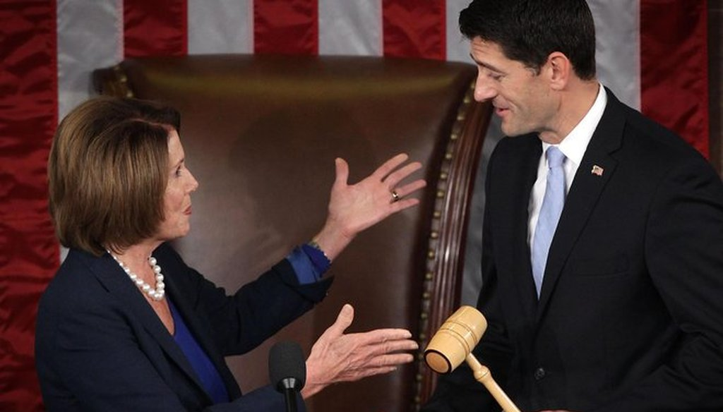 U.S. House Minority Leader Rep. Nancy Pelosi hands a gavel to incoming Speaker Paul Ryan on Oct. 29, 2015, shortly before he was sworn in. (Getty Images)