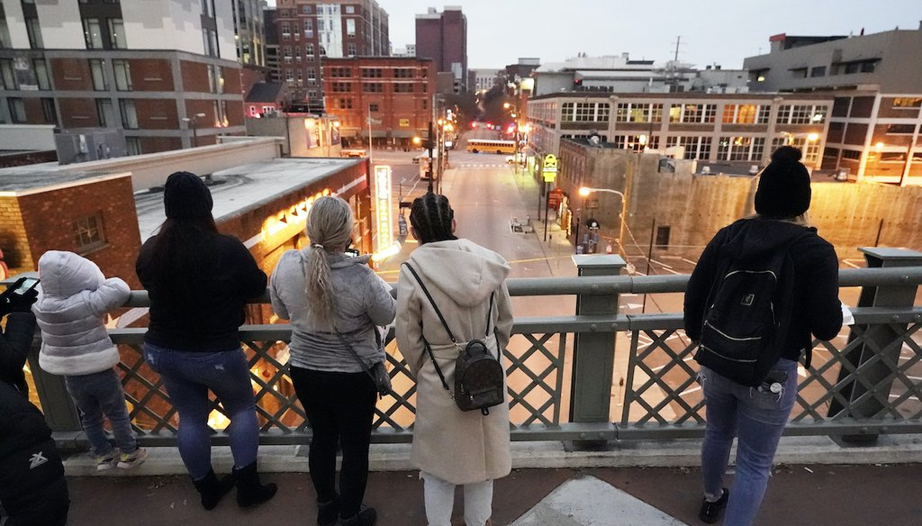 People look from a pedestrian bridge, Monday, Dec. 28, 2020, to view the area several blocks away where an explosion took place Christmas Day in Nashville, Tenn. (AP)