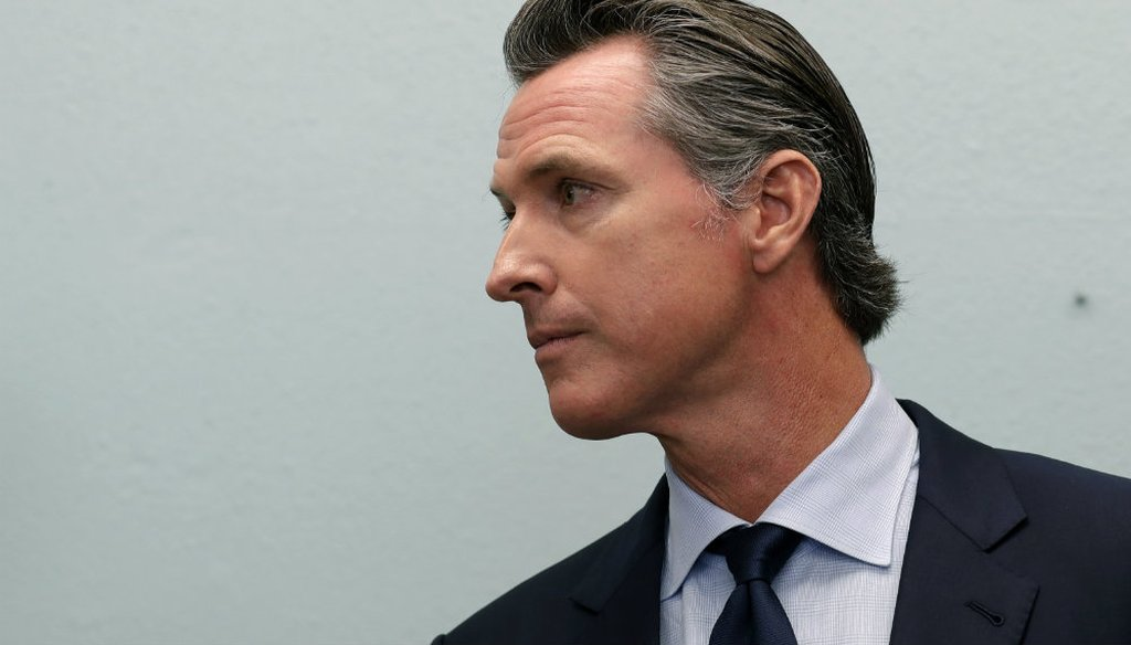 California Governor-elect Gavin Newsom looks on during a news conference near the border Thursday, Nov. 29, 2018, in San Diego. (AP Photo/Gregory Bull)