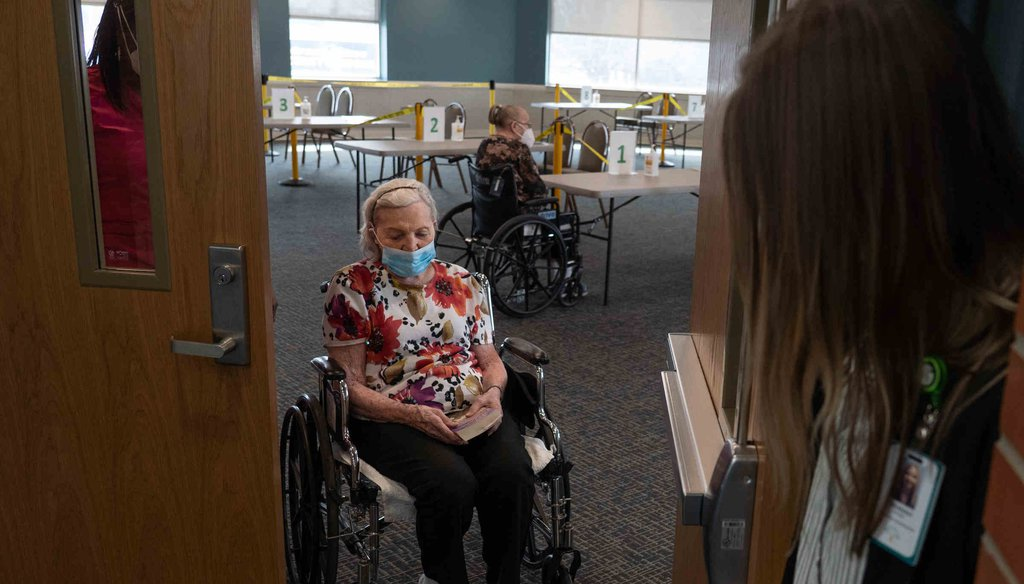 Evelyn Probst, 97, a nursing home resident at the Martha T. Berry Medical Care Facility in Mount Clemens exits the room after seeing her daughter (Detroit Free Press, Ryan Garza)