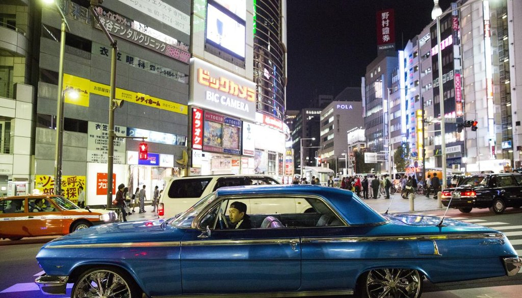 A man drives a 1962 Chevy Impala in Shibuya, a ward of Tokyo, Japan on Oct. 30, 2015.  (Eve Edelheit | Tampa Bay Times)