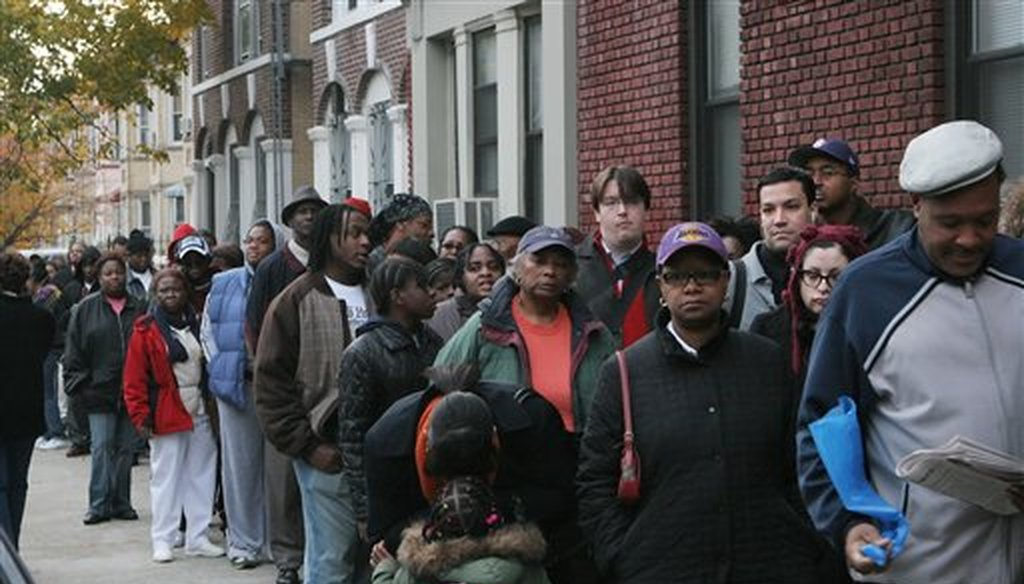 In this Nov. 4, 2008 file photo, voters, many waiting more than an hour before the P.S. 92 polling site opened, stand in a line that snaked nearly three blocks in the Flatbush section of Brooklyn, New York. (AP)