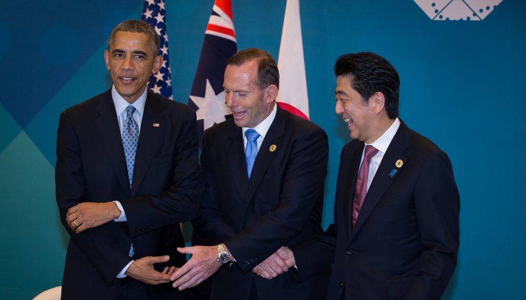 President Barack Obama, Australian Prime Minister Tony Abbott and Japan Prime Minister Shinzo Abe meet during a trilateral meeting at the G20 Summit on Nov. 16, 2014, in Brisbane, Australia.