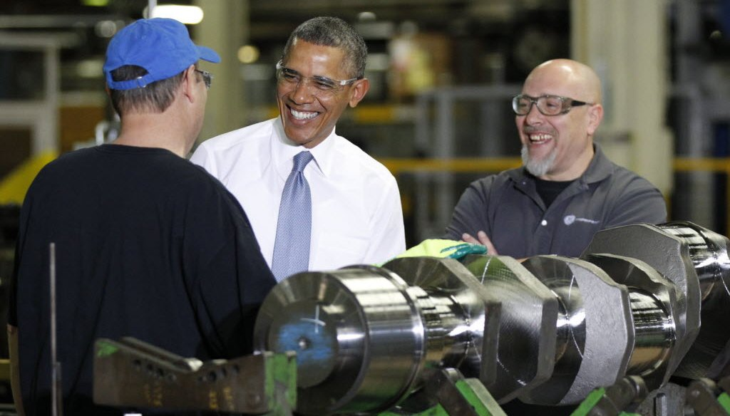 President Barack Obama spoke with employees Calvin Anderson (blue hat) and Ted Korber at a GE gas engines plant in Waukesha, Wis., on Jan. 30, 2014.