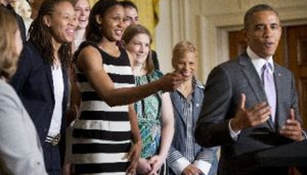 Minnesota Lynx basketball player Maya Moore, center, playfully reaches out to President Barack Obama during a ceremony at the White House on June 12, 2014.