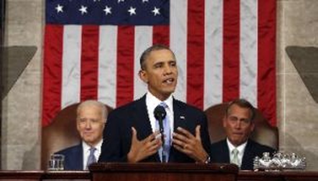 President Barack Obama, flanked by Vice President Joe Biden and House Speaker John Boehner, R-Ohio, gives the 2014 State of the Union address.