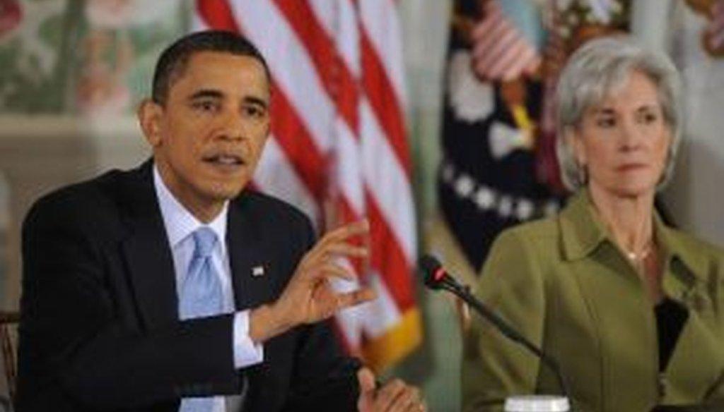 President Barack Obama speaks and Health Secretary Kathleen Sebelius looks on at Thursday's bipartisan health care summit.