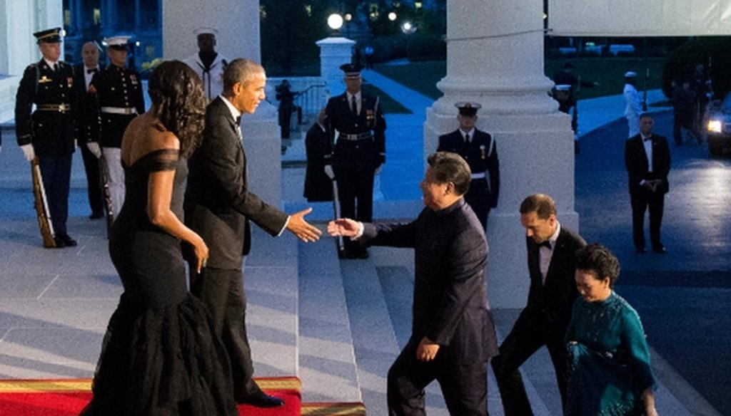 President Barack Obama and first lady Michelle Obama greet Chinese President Xi Jinping and his wife Peng Liyuan as they arrive for a State Dinner on Sept. 25, 2015, on the North Portico of the White House. (AP/Andrew Harnik)
