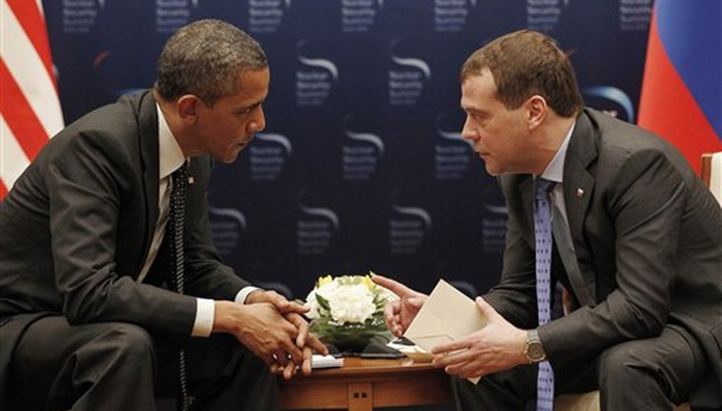 U.S. President Barack Obama, left, and Russian President Dmitry Medvedev chat during a bilateral meeting at the Nuclear Security Summit in Seoul, South Korea, Monday, March, 26, 2012. (AP)