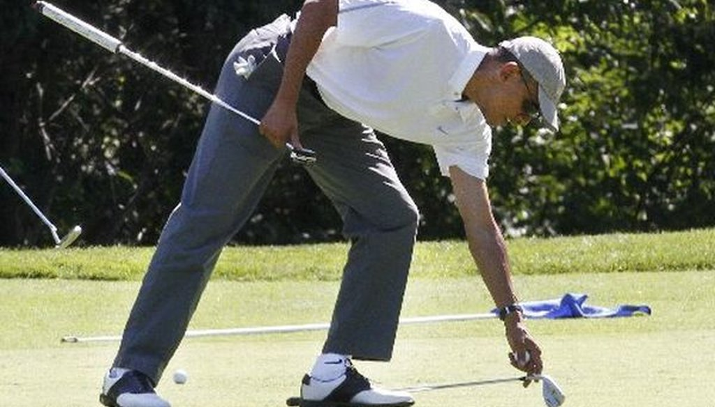 President Barack Obama golfs at Farm Neck Golf Club in Oak Bluffs, Mass., on the island of Martha's Vineyard, on Aug. 9, 2014.