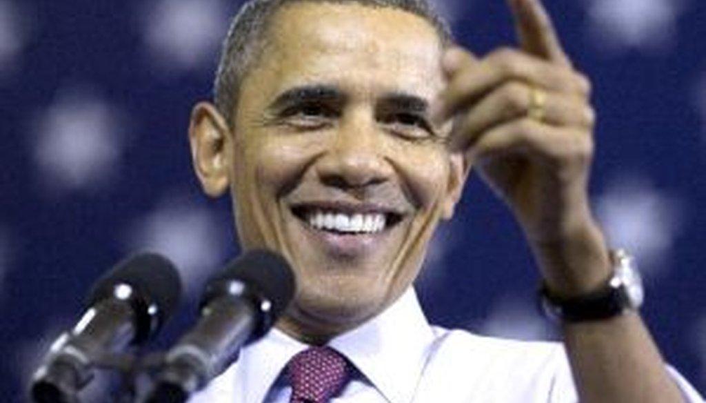 President Barack Obama gestures while speaking at Scranton High School in Scranton, Pa., on Nov. 30, 2011.