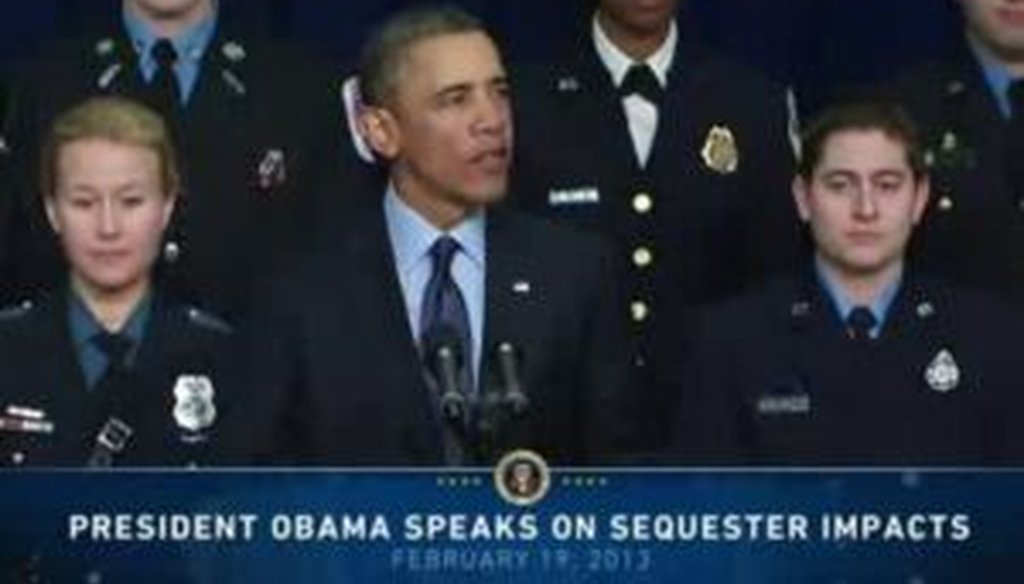 President Barack Obama, surrounded by uniformed law enforcement officers, outlined pitfalls of a budgetary sequester during a speech on Feb. 19, 2013.