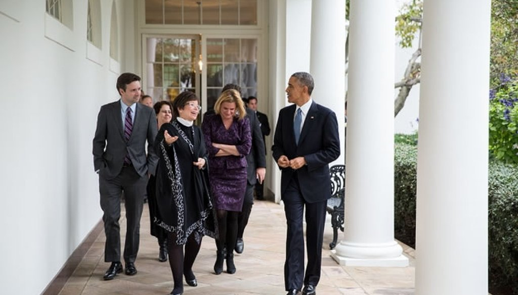 President Barack Obama walks with his advisers the day after Republicans won control of the Senate. (White House photo)