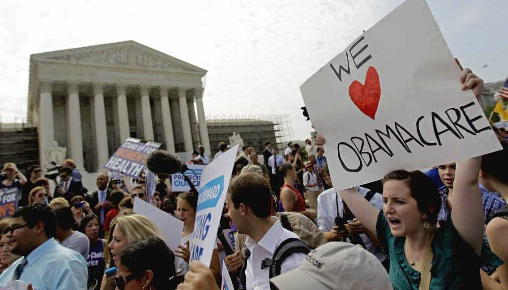 Supporters of the health care reform law celebrate June 28, 2012, outside the Supreme Court in Washington.