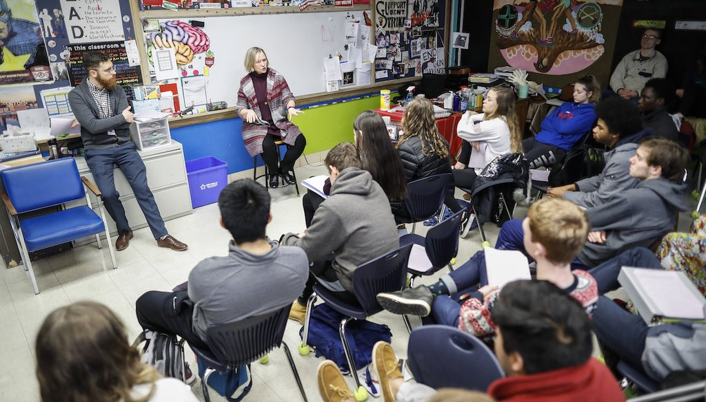 In this 2019 photo, students listen as social studies teachers lead the introductory class of their American Thought and Political Radicalism course at Worthington High School in Ohio. (AP Photo/John Minchillo)