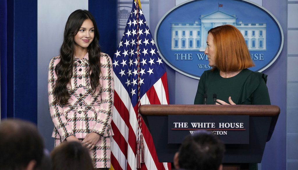 White House press secretary Jen Psaki looks at teen pop star Olivia Rodrigo during the daily briefing at the White House in Washington, Wednesday, July 14, 2021. Rodrigo is at the White House to film a video to promote vaccines. (AP)
