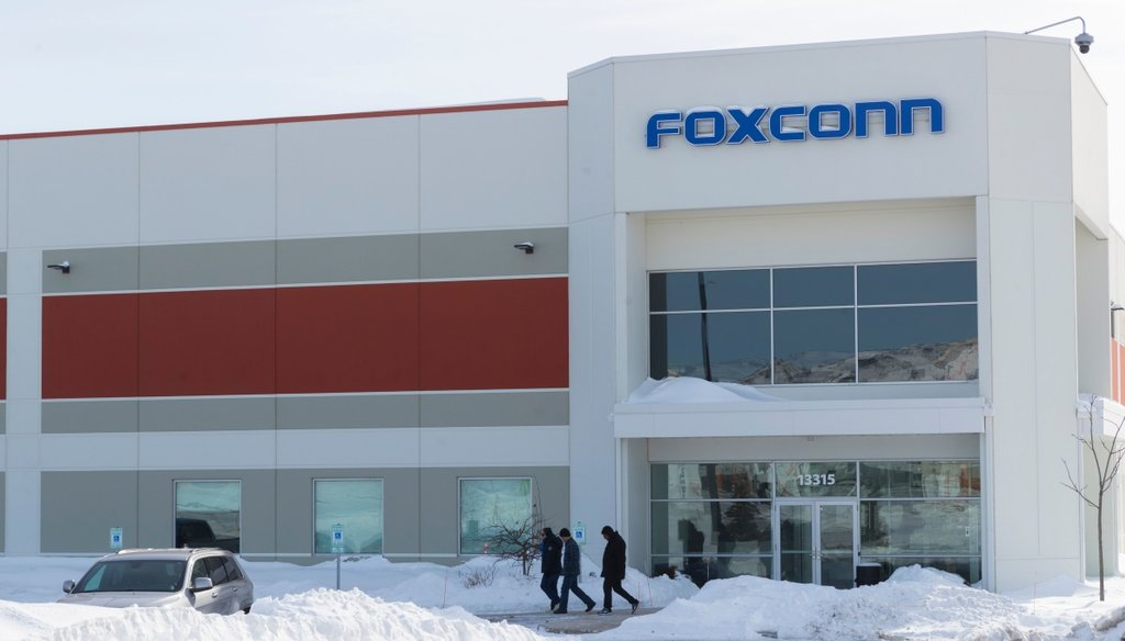A group exits a Foxconn building on Globe Drive in Mount Pleasant on Feb. 10, 2019. Mark Hoffman/Milwaukee Journal Sentinel