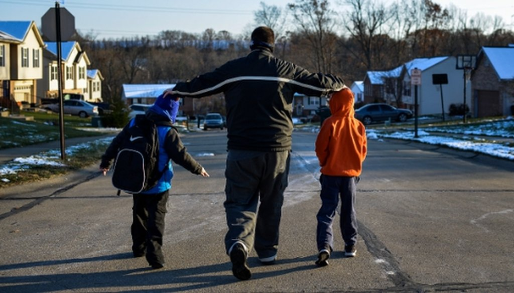 Alex Vories, who lost his job and has since run out of unemployment benefits, with his sons, Caleb, 9, right, and Josh, 6, in Alexandria, Ky., on Nov. 20, 2014. (New York Times)