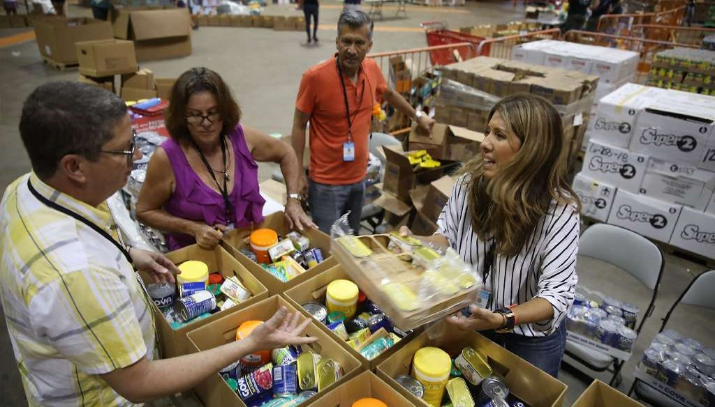 Workers sort relief supplies in a stadium in San Juan, Puerto Rico, on Sept. 30, 2017. (Getty Images photo)