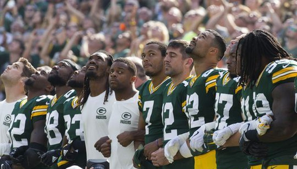 Green Bay Packers players locked arms during the national anthem prior to the team's game on Sept. 24, 2017 at Lambeau Field in Green Bay, Wis. (Mark Hoffman/Milwaukee Journal Sentinel)