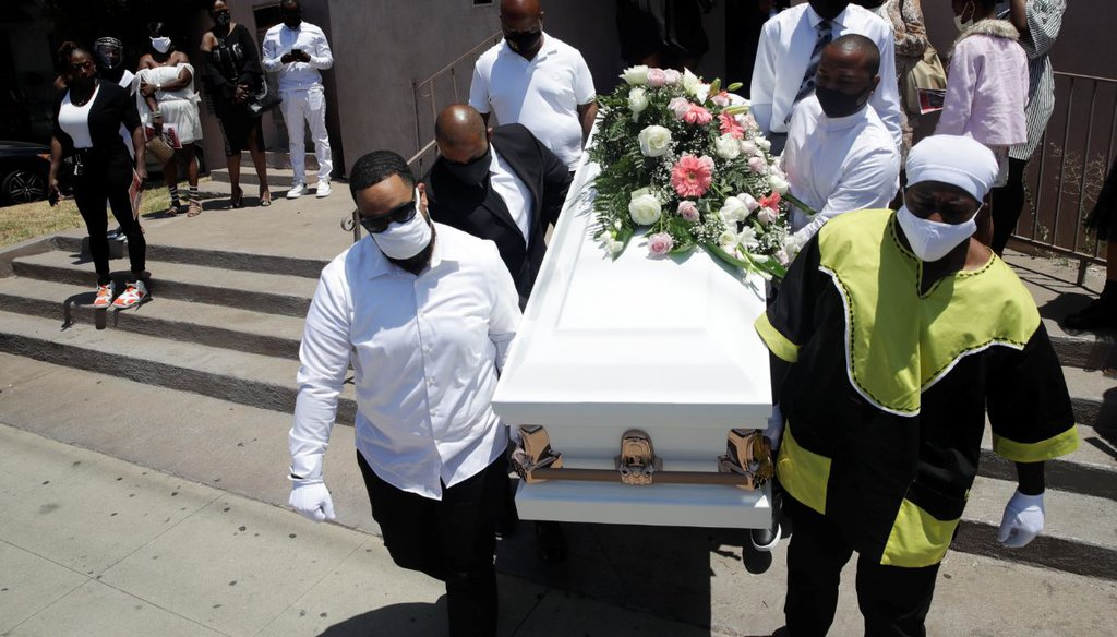 Pallbearers carry a casket with the body of Lydia Nunez, who died from COVID-19, after a funeral service in Los Angeles on July 21, 2020. (AP)