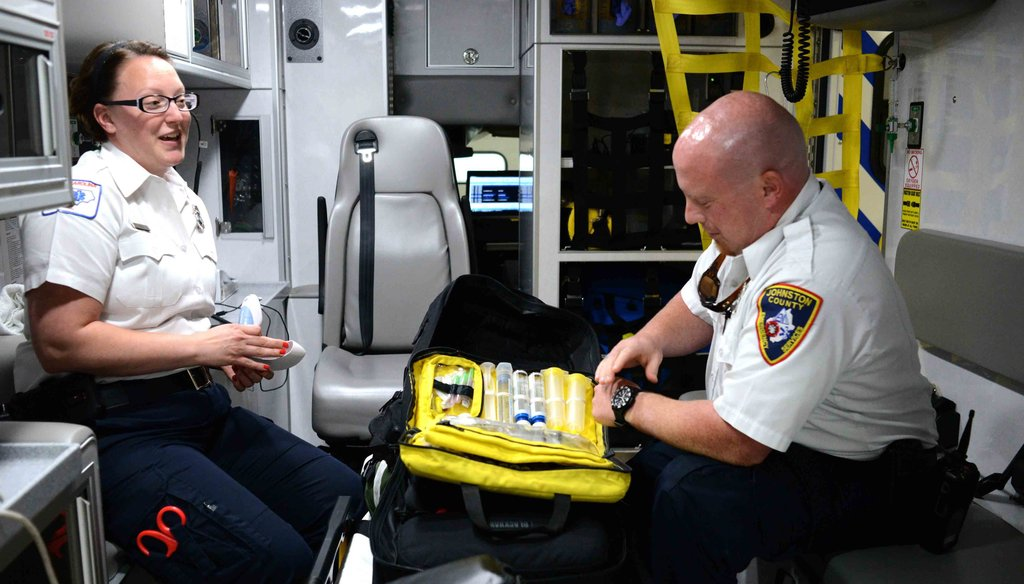 Two North Carolina paramedics show their naloxone, a substance that can reverse an opioid overdose.