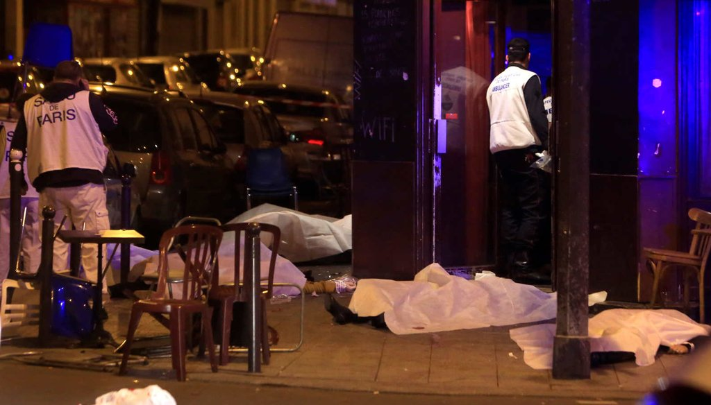 Victims's bodies lie on the sidewalk outside a Paris restaurant following a wave of attacks Friday. (AP)