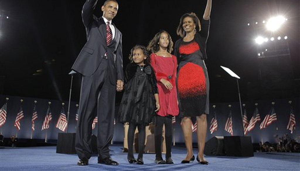 President Barack Obama with his wife Michelle Obama and his two daughters, Sasha and Malia, at an election night rally in Chicago on Nov. 4, 2008. (AP/Hong)